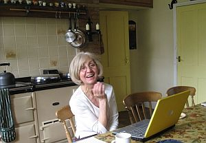 Barbara Read at laptop in farm house kitchen